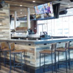 view of multigrain wood slat bar designed by Lighthouse Architecture.